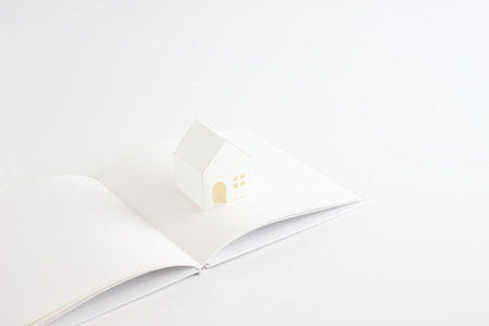 excise: toy house and white book on the white background Stock Photo