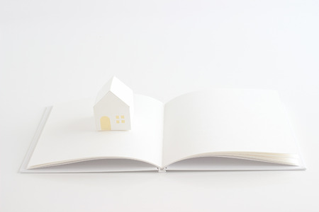 toy house and white book on the white background Standard-Bild