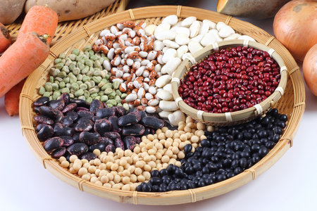 colander: variety beans and vegetables on colander Stock Photo