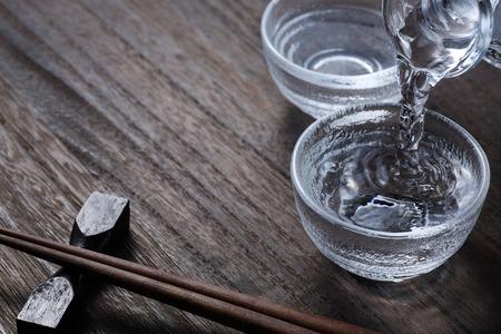 pouring japanese sake Stock Photo