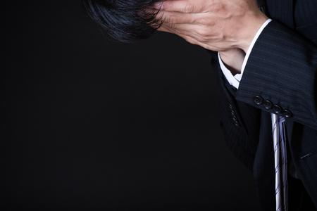 asian businessman on black background