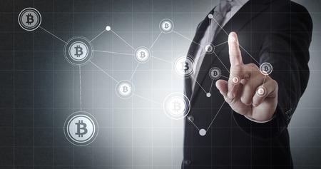 Businessman pointing at Bitcoin