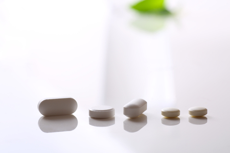 many tablets on white background