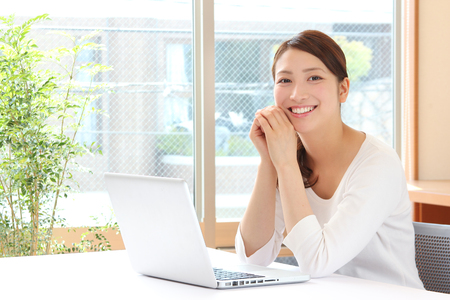young asian woman using laptop Stock Photo