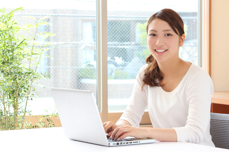 young asian woman using laptop 写真素材