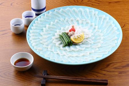 japanese sake and blowfish sashimi on the table