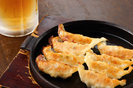 Japanese dumplings and beer on the table