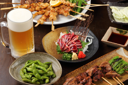 beer and japanese cuisine on the table Archivio Fotografico