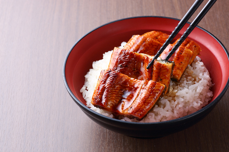 bowl of rice topped with broiled eel
