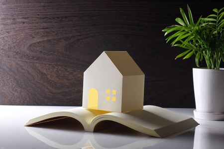 model of house and book on the table
