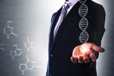 businessman holding glowing dna helix