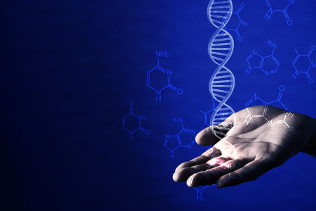 businessman holding dna helix