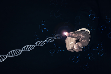 businessman pointing glowing dna helix