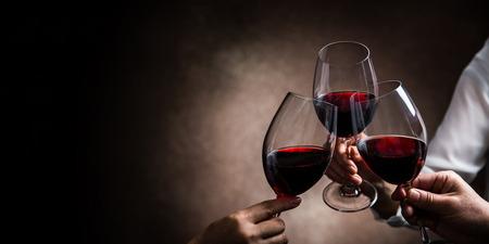 toasting with three wine glasses