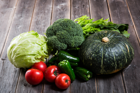 many vegetables on grunge wooden table