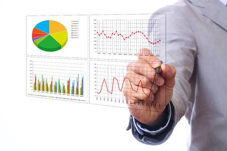 Asian businessman pointing at business chart