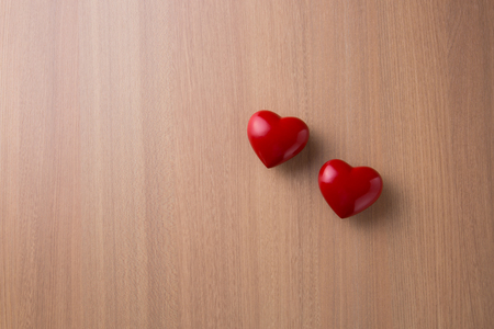 Two hearts on wooden table 写真素材
