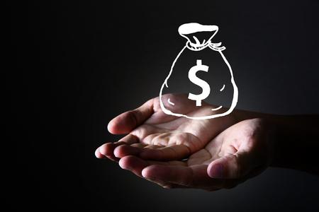 Human hand with dollar bag Stock Photo