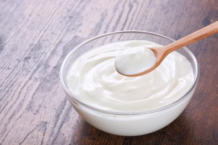 White Yogurt on wooden table