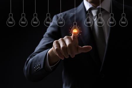 Businessman pointing light bulb