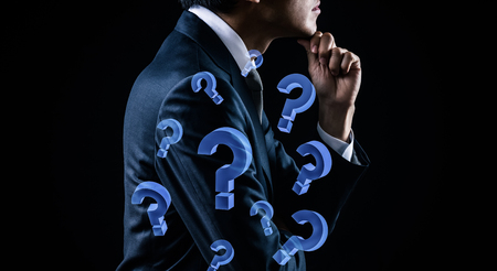 Businessman thinking and 3d question mark