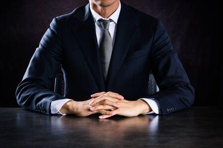 Asian businessman sitting at desk