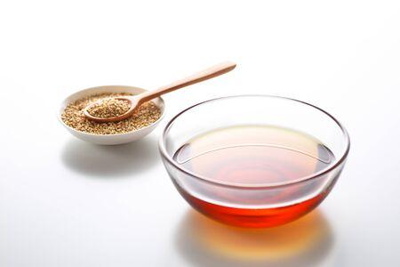 Sesame oil on white background Stockfoto