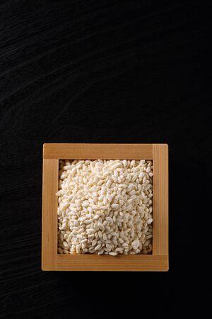 Japanese Rice koji on black wooden table