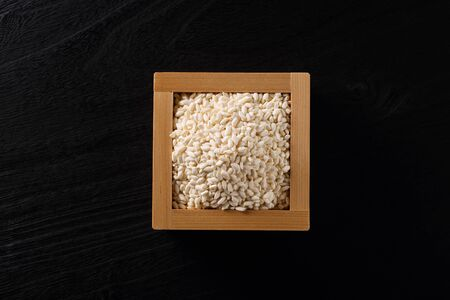 Japanese Rice koji on black wooden table