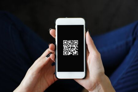 Qr code displayed on the smartphone screen Stock Photo
