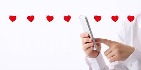 human hand using smartphone on white background 写真素材