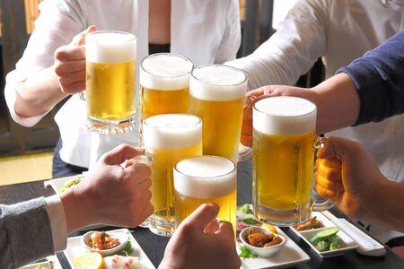 Toasting with beer at a Japanese izakaya