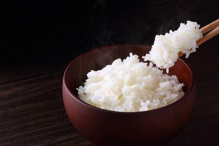 japanese white rice on black background Foto de archivo
