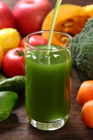 Pouring vegetable juice into a glass