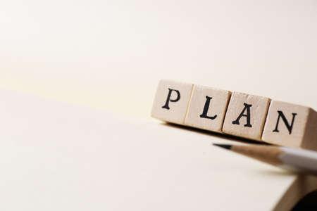 PLAN word written on wood block
