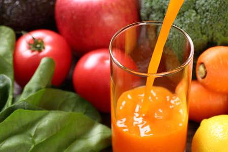 Orange vegetable juice and ingredients Stock fotó