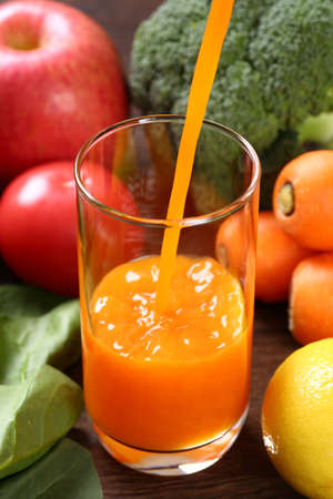 Orange vegetable juice and ingredients 写真素材