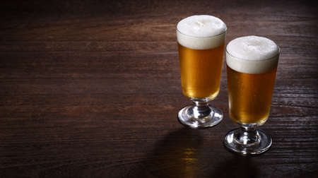Craft beer on wooden table 写真素材