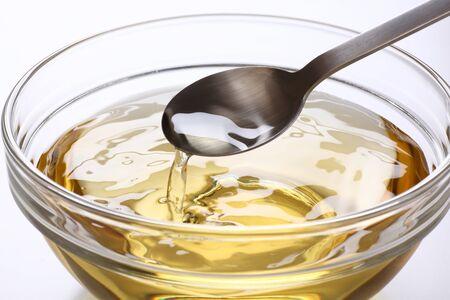 Scoop vinegar with a spoon