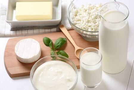Many dairy products on white background