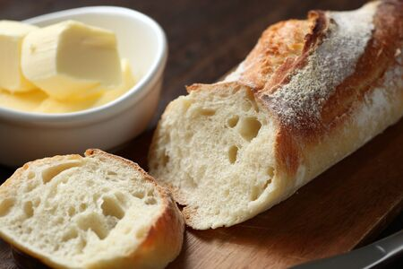 Cut baguette and butter on the table