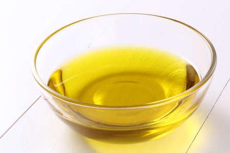 Fresh olive oil on white table