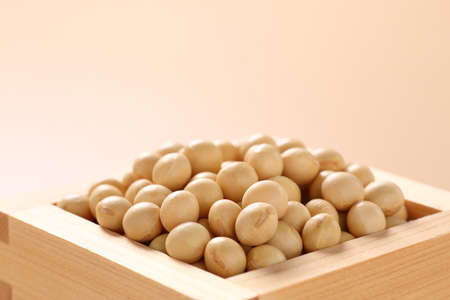 Soybeans on a beige background