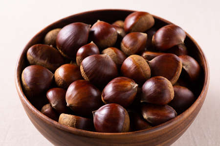 Lots of chestnuts in a wooden bowl