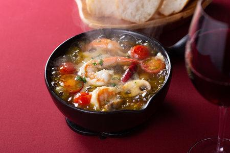 Shrimp and mushroom ajillo on the table