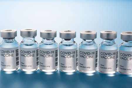Aligned COVID-19 vaccines on blue background