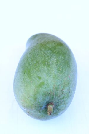 Green mango on a white background