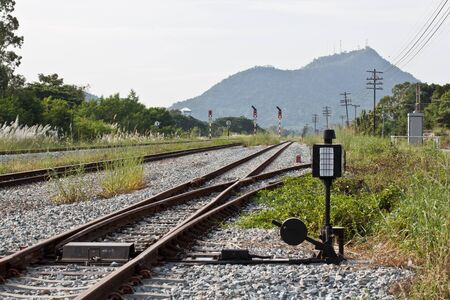 Hand-operated railroad switch with lever, weight and signal