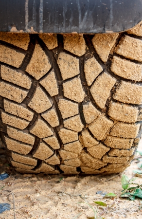 The tire on a dirt road Stock Photo - 20949852
