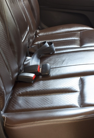 Modern car interior - rear seats with the seat belts Stock Photo - 21453149